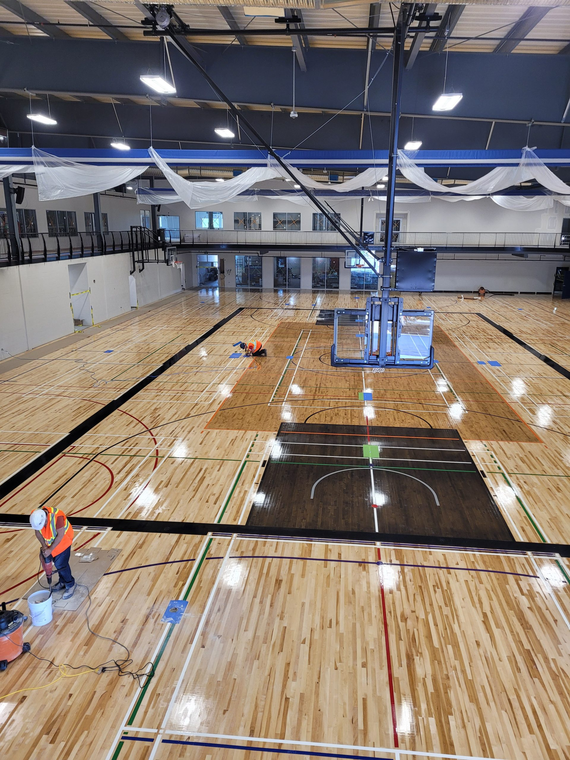 June 2021 - Still working on the fieldhouse floor lines!